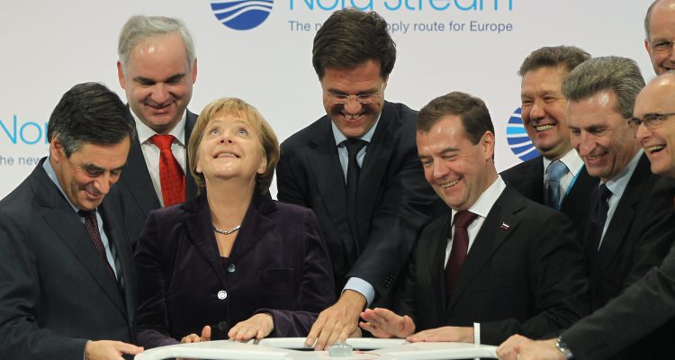 LUBMIN, GERMANY - NOVEMBER 08:  (From L to R, first row) French Prime Minister Francois Fillon, German Chancellor Angela Merkel, Dutch Prime Minister Mark Rutte, Russian President Dmitry Medvedev and European Union Energy Commissioner Guenther Oettinger turn a wheel to symbolically start the flow of gas through the Nord Stream Baltic Sea gas pipeline at a cemerony on November 8, 2011 in Lubmin, Germany. The Nord Stream pipeline runs through the Baltic Sea and will supply Europe with natural gas from Russia.  (Photo by Sean Gallup/Getty Images)