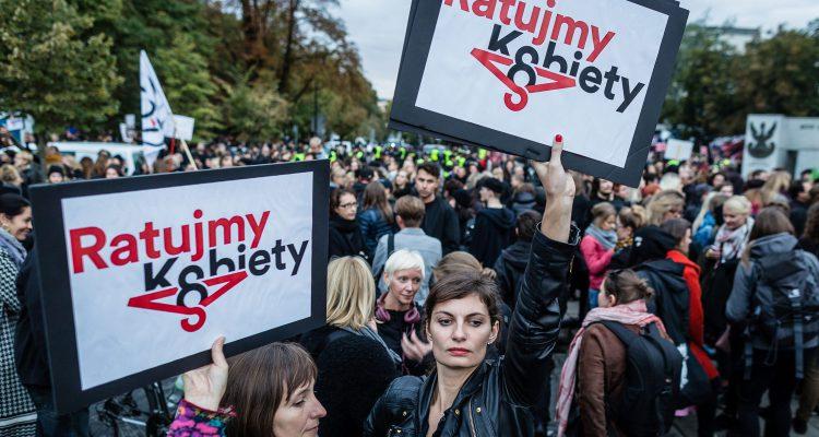 People attend the anti-government, pro-abortion demonstration in front of the Polish Pariament in Warsaw on September 22, 2016.  / AFP / WOJTEK RADWANSKI        (Photo credit should read WOJTEK RADWANSKI/AFP/Getty Images)