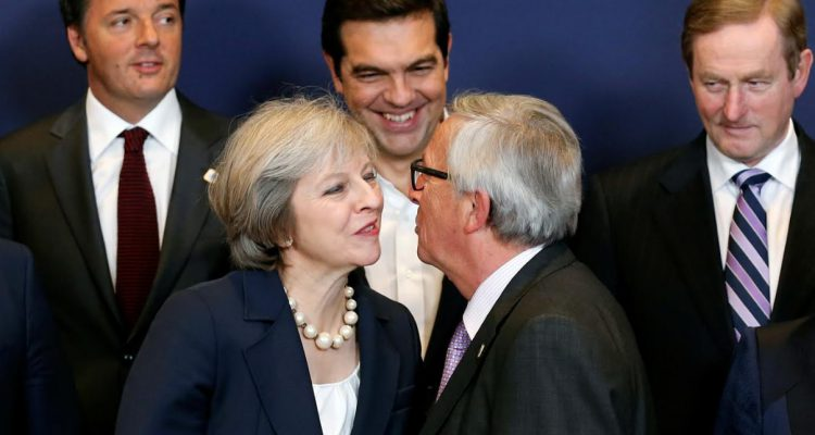 european-commission-president-jean-claude-juncker-kisses-britains-prime-minister-theresa-may